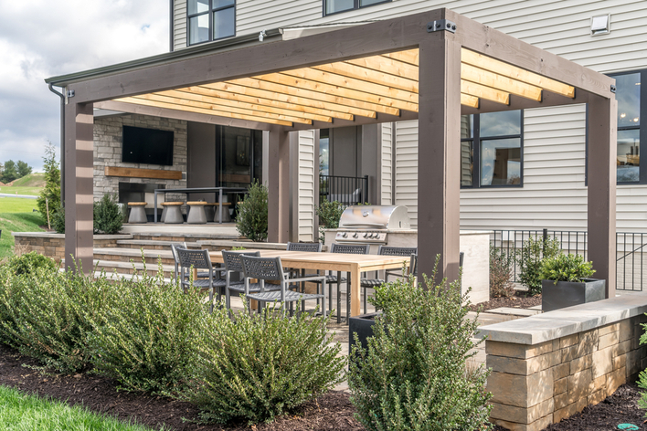 A backyard pergola on an outdoor deck