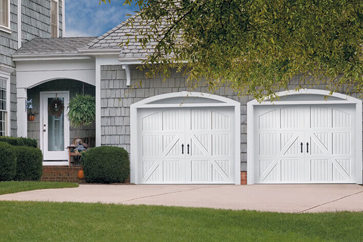 Closed garage doors with cars parked inside