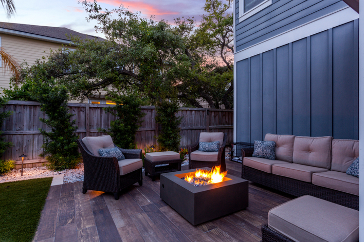 Patio furniture gathered around a fire pit