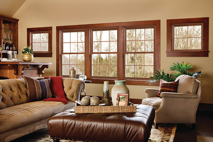 Natural wood framed windows are used to remodel a ranch home living room