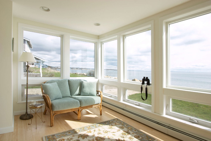 A beach house living room with large windows