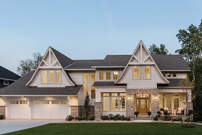 Front of a house with outdoor lighting