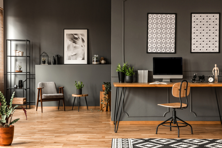 Wooden home office desk in a gray apartment