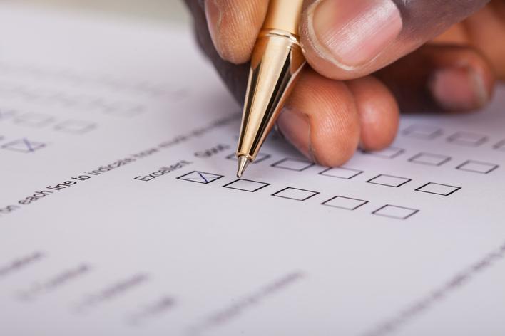 A man filling out a survey