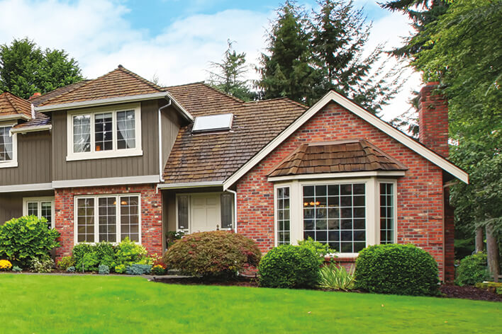 A traditional home showing double-hung style windows