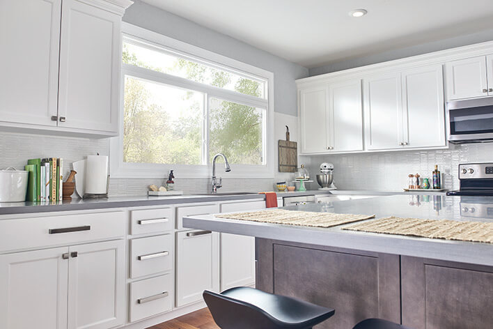 A clean kitchen with white cabinets