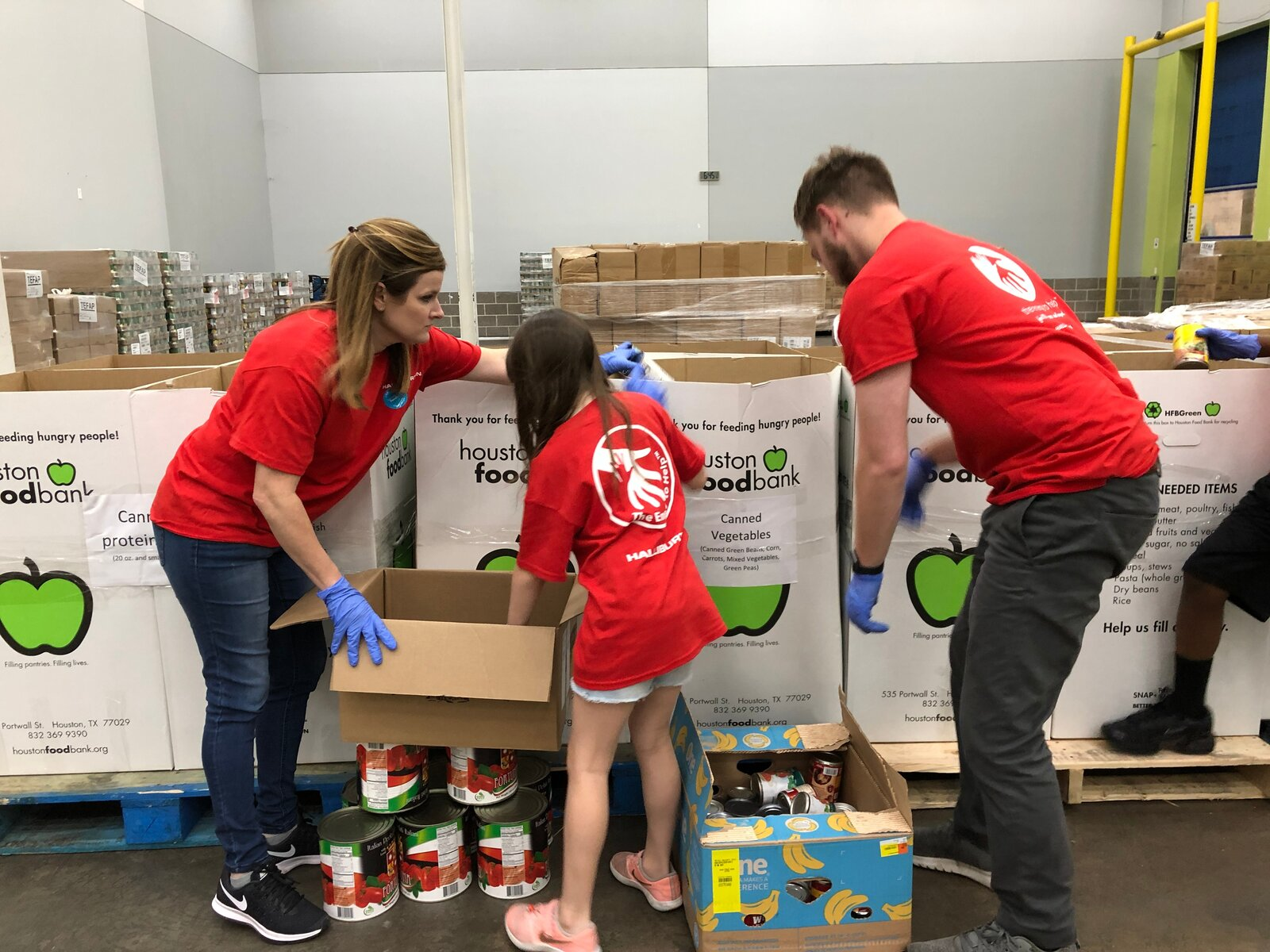 Halliburton and their families volunteer at Houston Food Bank
