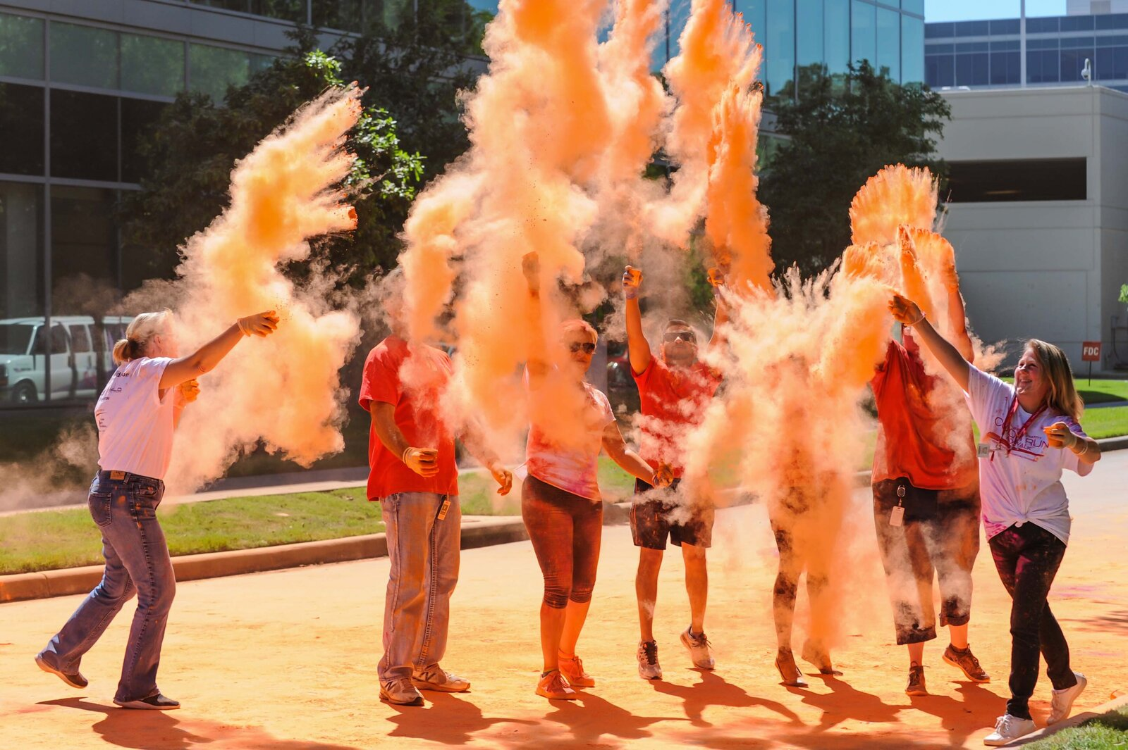 Halliburton employees raise funds for MD Anderson Cancer Center, St. Jude's Children's Research Hospital and Camp Quality during color run event.