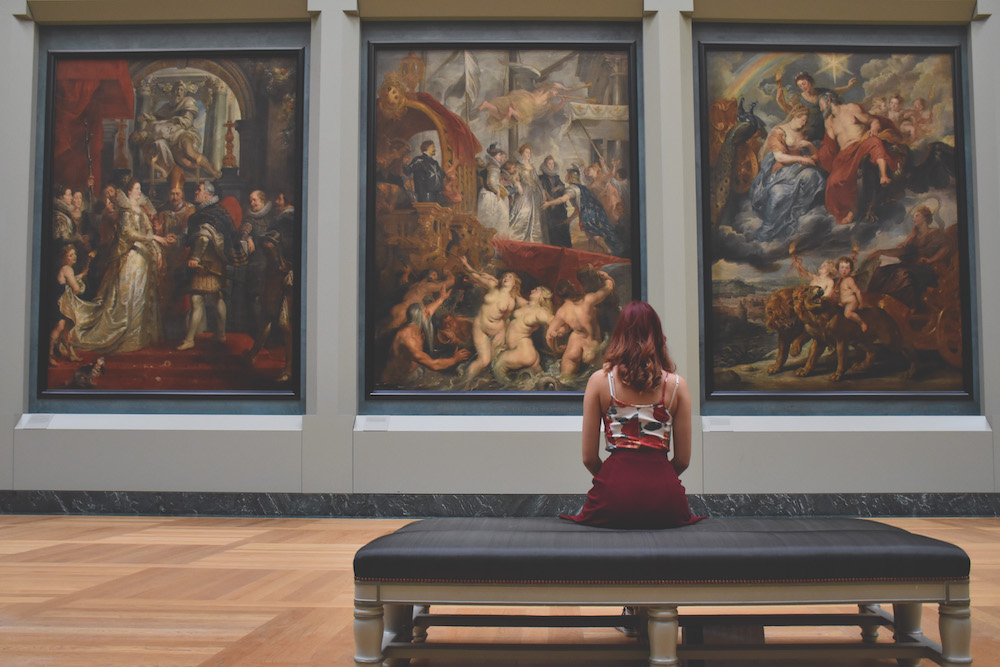 woman sitting on a bench at a museum
