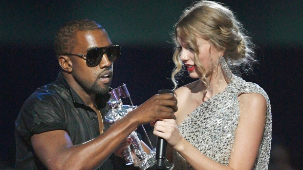 Taylor Swift receiving grammy and Kanye West shooting her down