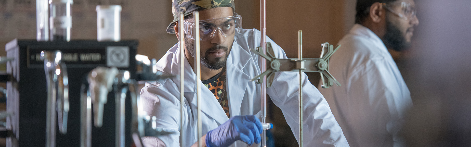 Student working with chemicals in a lab