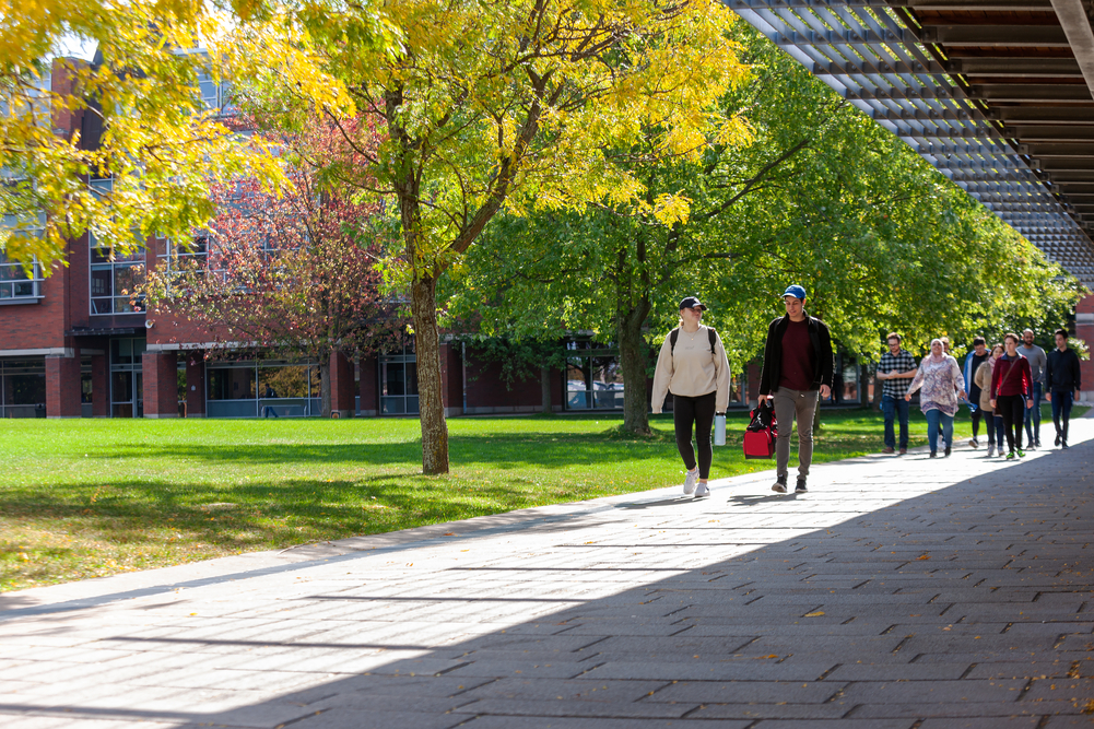 Students walking in Polonsky Commons