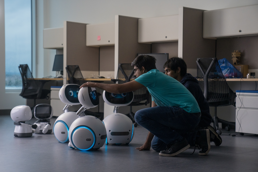 Students working with AI robots