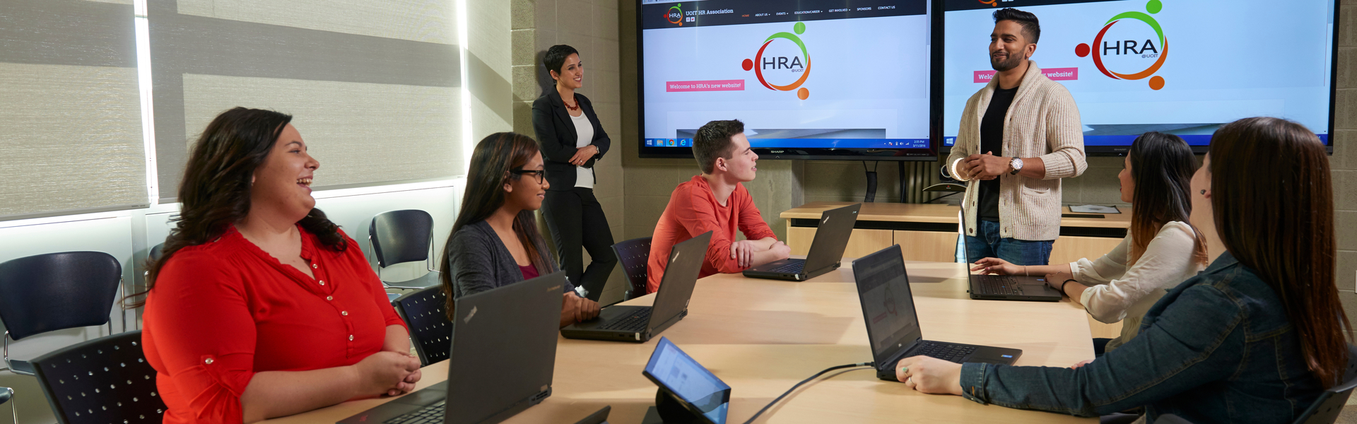 Students collaborating in a meeting room