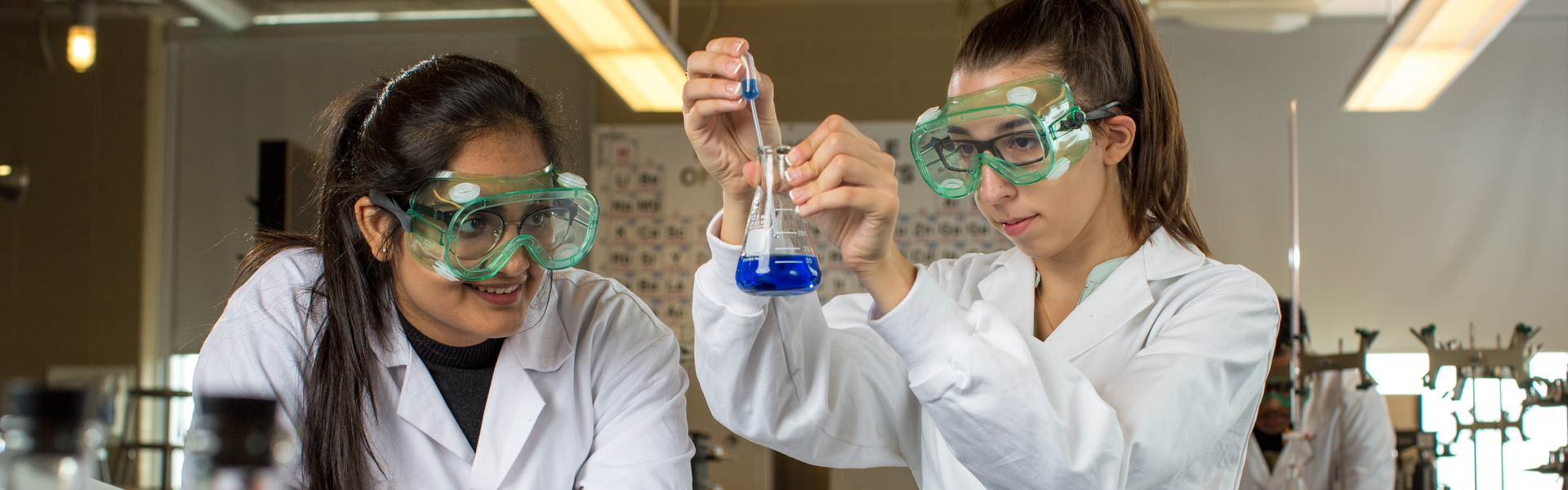 Students in a lab working with chemicals