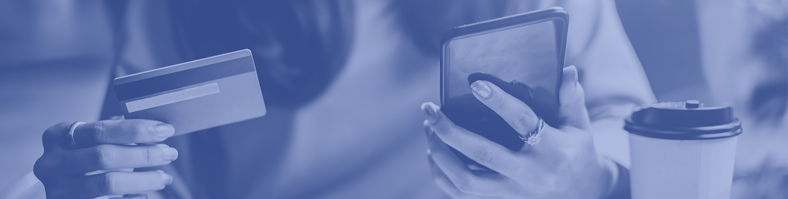 woman holding credit card and phone in her hands header image
