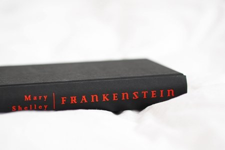 black Frankenstein book in a white sheet