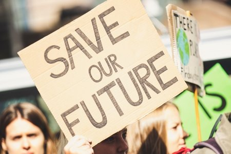 "Woman holding ""Save Our Future"" sign"