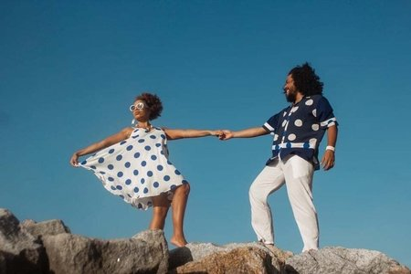 Man and woman with fashion clothes from the Brazilian brand Negro Piche