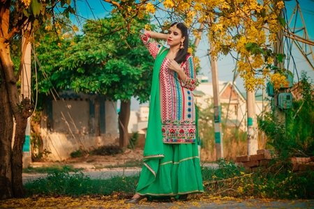 Punjabi woman wearing green attire outdoors