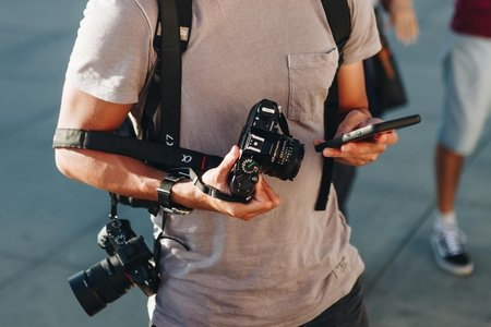 man with cameras
