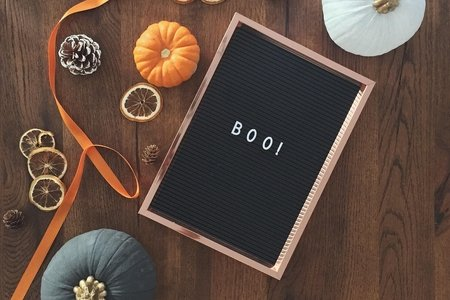 letter box with boo! on it and small pumpkins