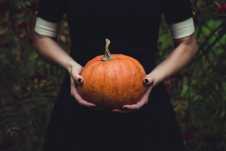 person holding a pumpkin