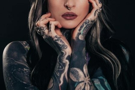 woman covered in tattoos