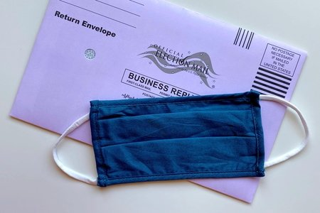 mail in ballot with mask by Tiffany Tertipes on Unsplash