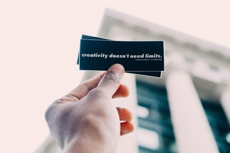"black paper that says ""creativity doesn't need limits"""