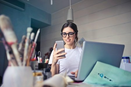 Woman with phone at desk