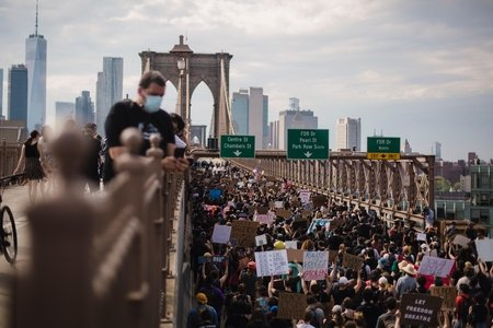 crowd of protesters on a bridge
