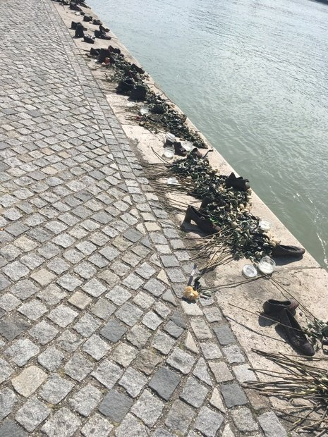 Boots sitting along the Danube to represent those who passed there, Budapest, Hungary