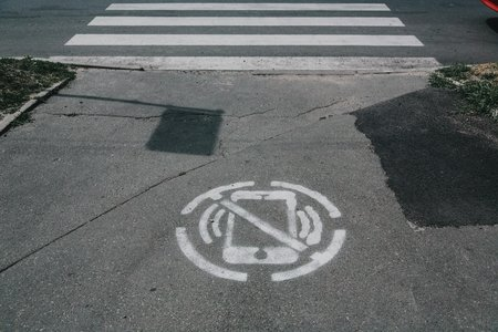 """A spray paint of a """"no phone"""" icon"""