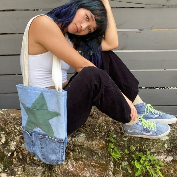 Mia Crisosto modeling a tote bag she sewed from upcycled materials