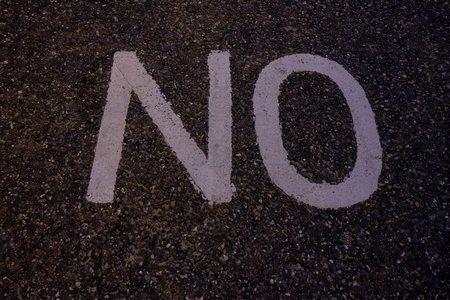 NO written on concrete