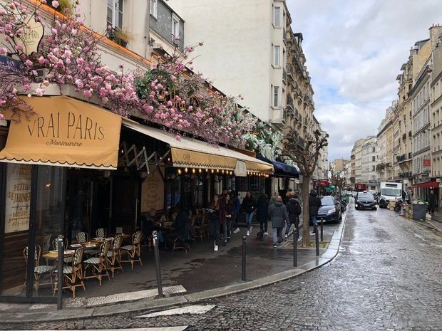 Paris streetview Montmartre cafe with pink flowers