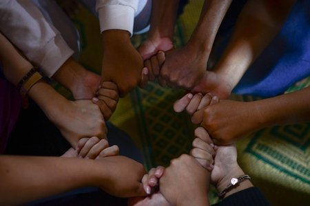 group of diverse people holding hands