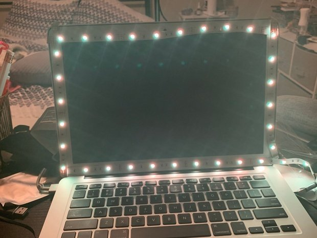 A laptop with LED lights around the screen
