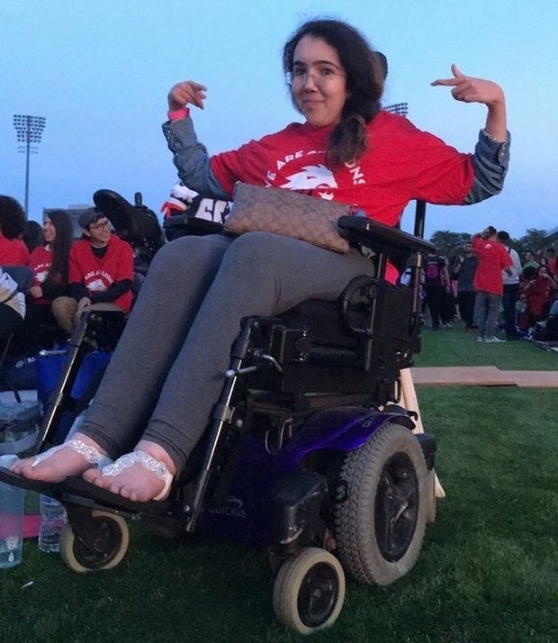 Woman in wheelchair at university sporting event.