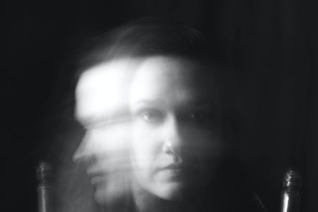 blurry black and white photo of woman