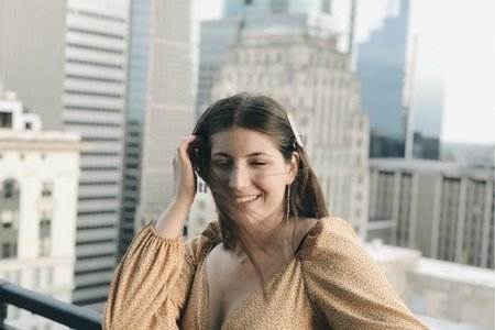 Woman on city rooftop