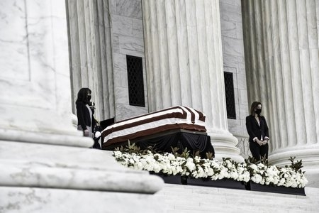 Ruth Bader Ginsburg's casket draped in an American flag resting in state on the capitol steps