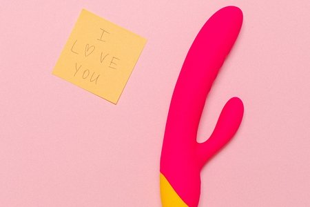 pink background with vibrator and sticky note saying I love you