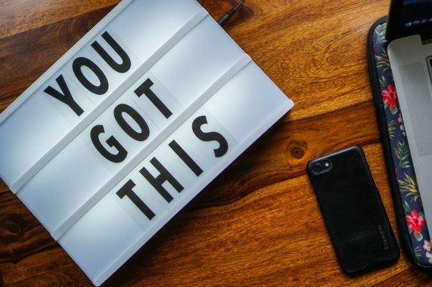"""""""You Got This"""" sign with iPhone next to it"""