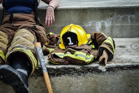 firefighter sitting on the stairs