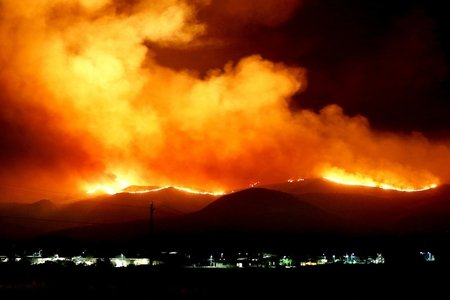 wildfire on rolling hills