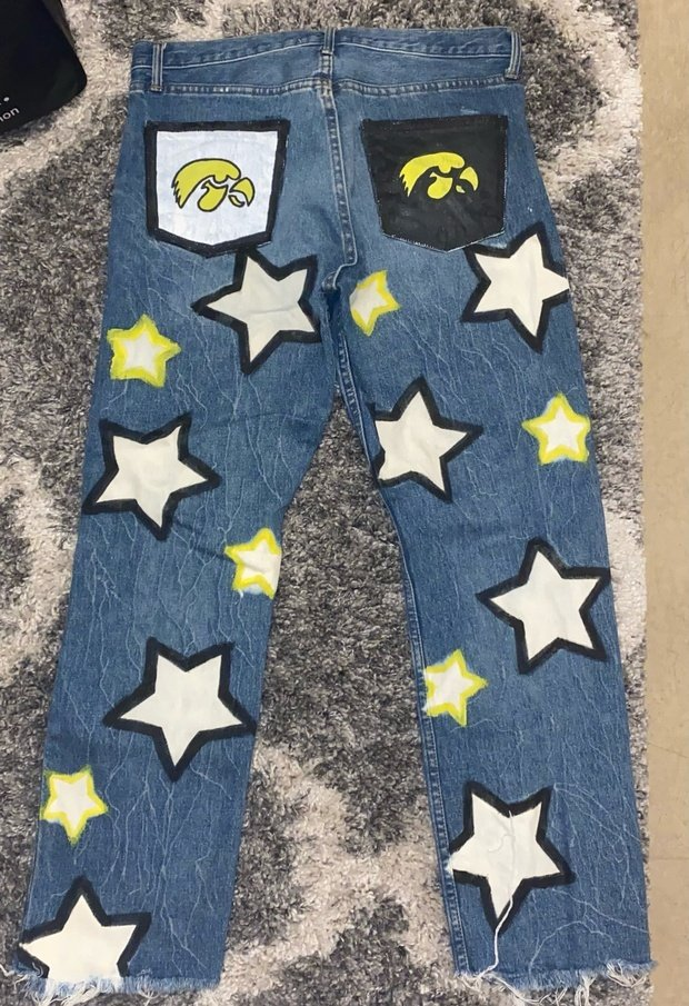 painted blue jeans with stars and hawkeyes