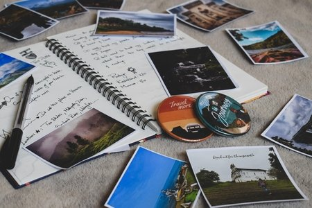 assorted travel photos and a notebook