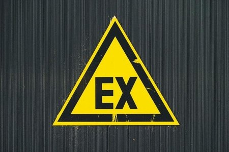 ex yellow and black sign